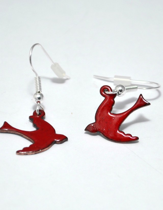 close up of pair of bright red enamel swallow bird earrings