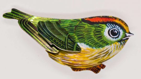 A small bird printed with a bright design of a goldcrest.