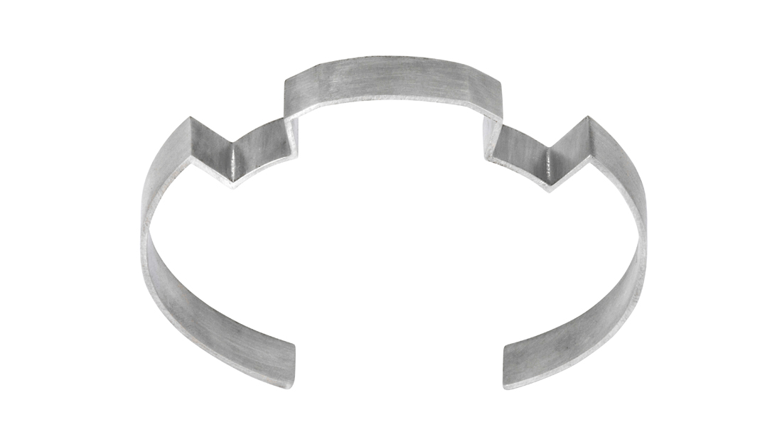 Interlocking stories bangle in silver. Simple and geometric in design.