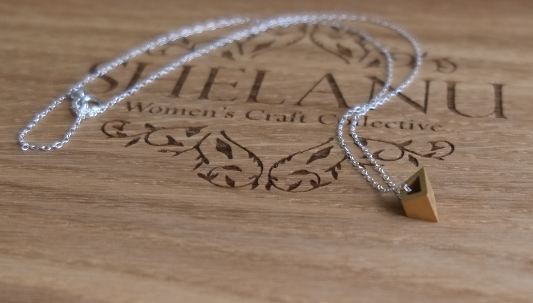 Shelanu Interlocking Stories necklace in gold with silver chain. Simple in design.