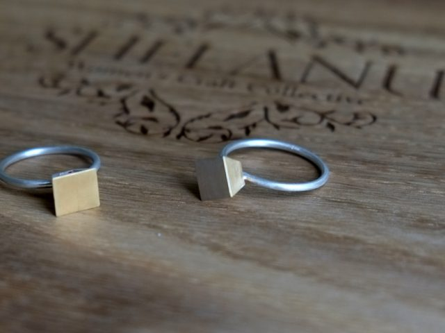 2 Shelanu Interlocking Stories range rings in part gold and silver, simple diamond and square stud design.