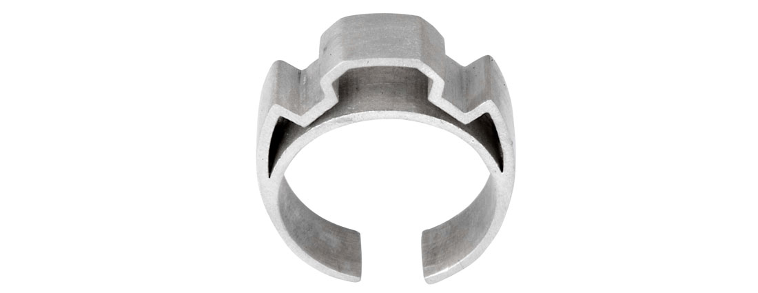 A chunky silver ring with a strong geometric shape.
