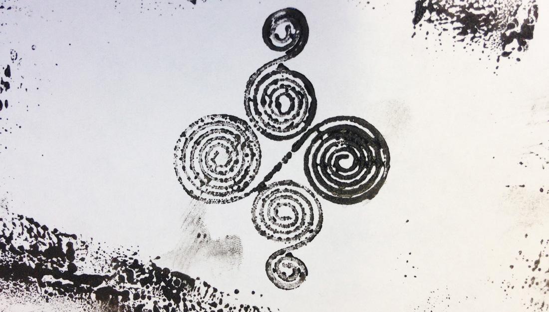 A swirl design printed using ink.
