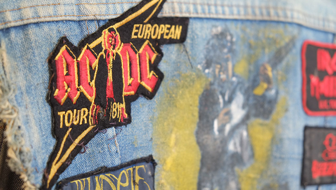 Battle jacket with various badges from past gigs in Birmingham.