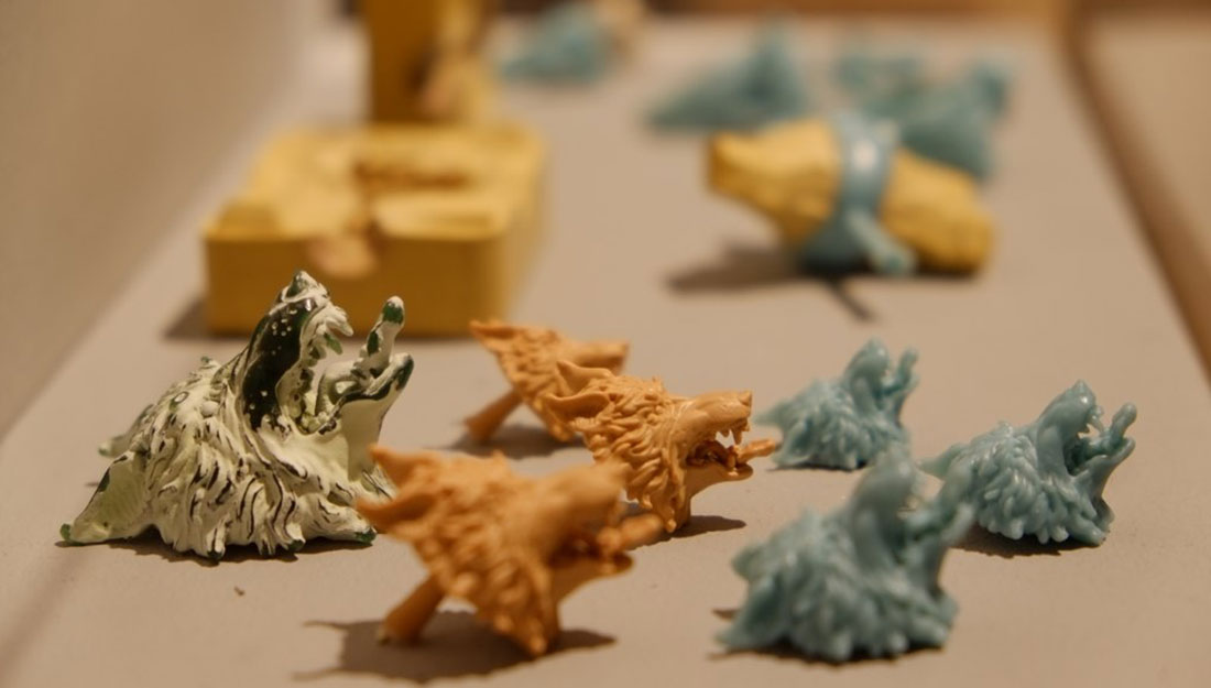 Cast moulds made from wax in orange, blue and yellow colours.
