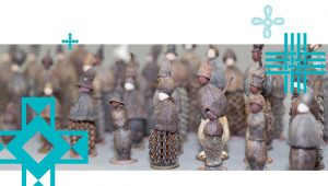 Lots of little figures made from nuts and seed cases.