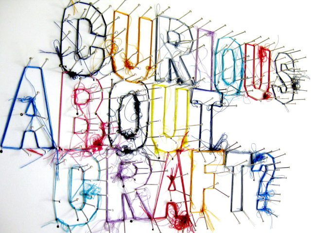 curious about craft is spelled out by pins wrapped in thread.