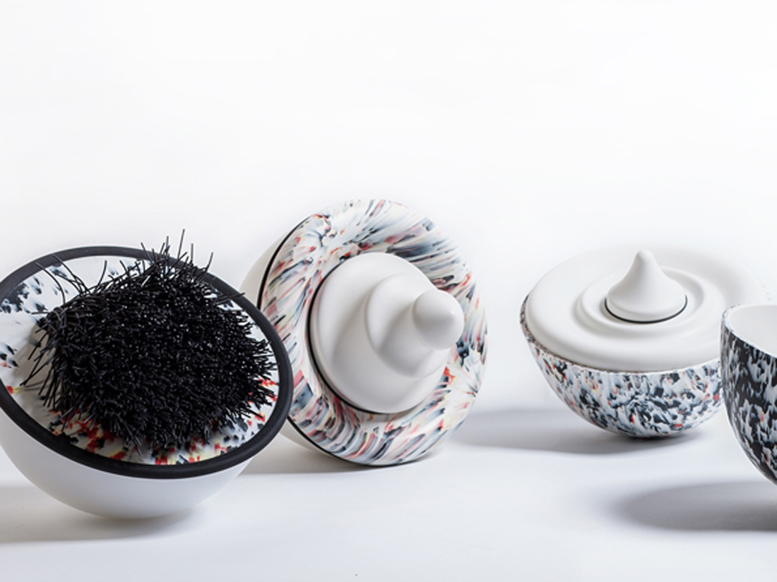 A group of small simple items made from a smooth, hard material. Cup-like forms with decoratoins like brushes and small knobs. Some are reminiscent of shaving brushes.