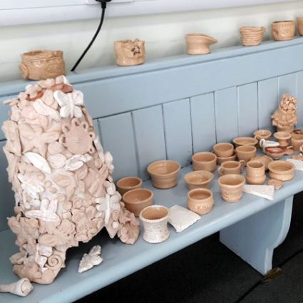 A display of clay items made during workshops.
