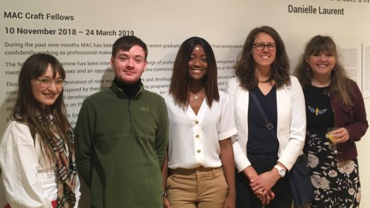 group of craft fellows standing together at their exhibition launch