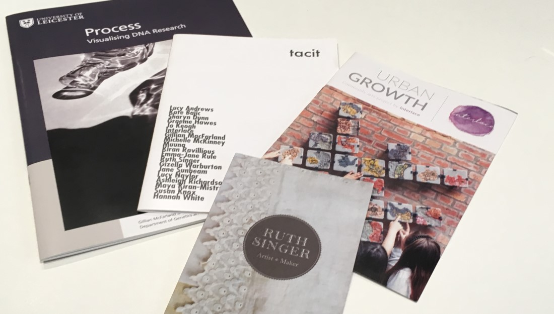 Variety of booklets lie on a surface.