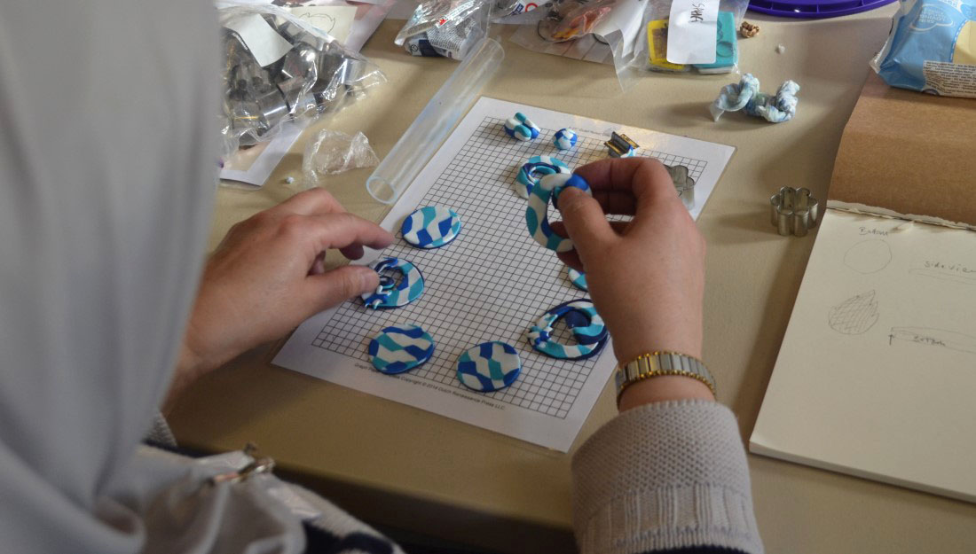 A participant lays out the design for her necklace