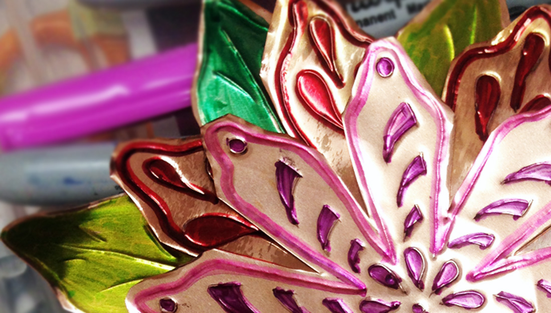 a flower design made from cut and coloured metal.